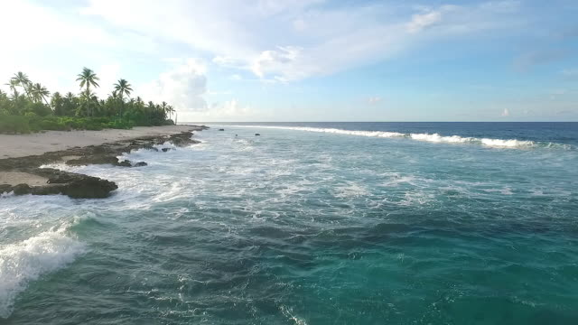 moving over coastline and breaking waves on manra atoll - micronesia stock videos & royalty-free footage