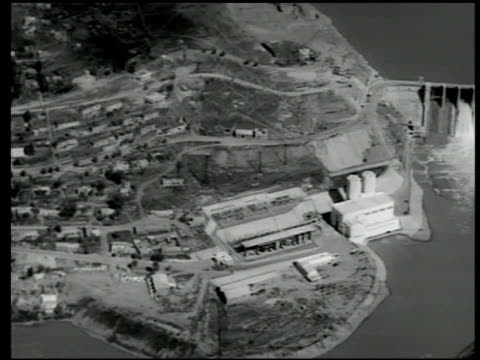 casablanca morocco dams aerial moving over dam hydroelectric plant in operation workers loifting gate on irrigation ditch cu water flowing - 1951 stock videos and b-roll footage