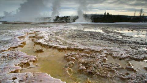 pov moving over hot springs at yellowstone caldera, yellowstone national park, wyoming, usa - yellowstone national park stock videos & royalty-free footage