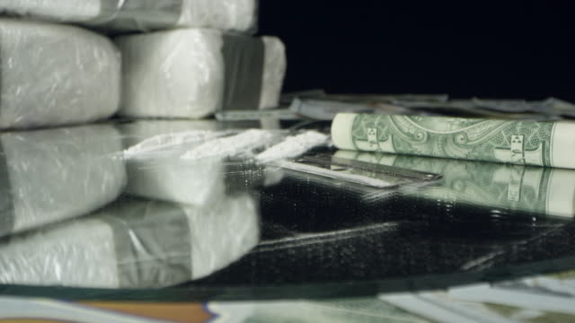 moving over money and drugs on table top - maultier stock-videos und b-roll-filmmaterial