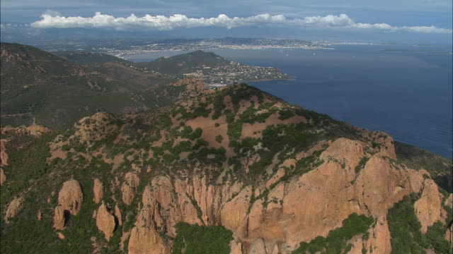 AERIAL Moving over mountains with Cannes in background/ Cannes, France
