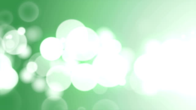 Moving Particles Loop - Abstract Green Defocused Lights Background