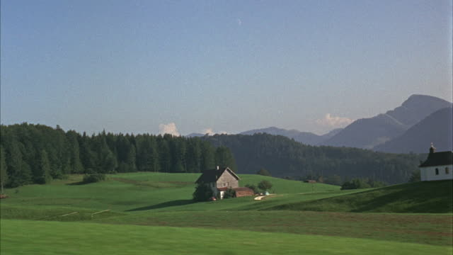 ws pov moving past rural scene / austria - austria video stock e b–roll