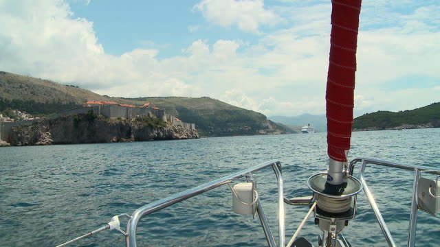 ws moving past st. john/s sailing toward surrounding wall and old part of city/ dubrovnik, dalmatia - surrounding wall stock-videos und b-roll-filmmaterial