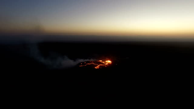 moving past view of erta ale volcanic activity (active basaltic shield volcano) at night - ale stock videos & royalty-free footage