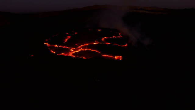 moving past view of erta ale volcanic activity (active basaltic shield volcano) - ale stock videos & royalty-free footage