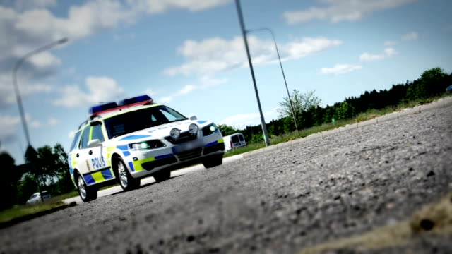 moving police car - swedish polis bil - sweden stock videos & royalty-free footage
