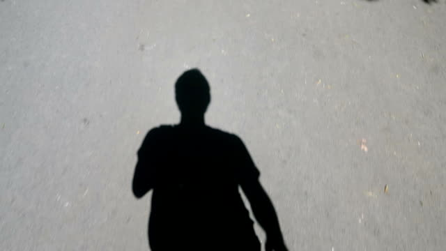 moving shadows of a men slow motion - stock video - shadow stock videos & royalty-free footage