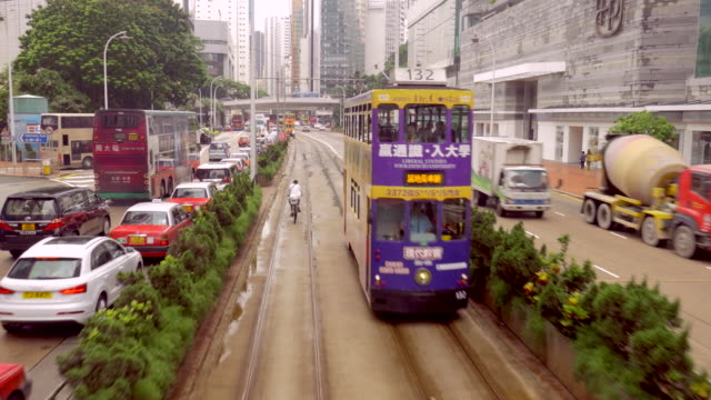 vídeos de stock, filmes e b-roll de moving shot along tram line in hong kong - ponto de vista de bonde