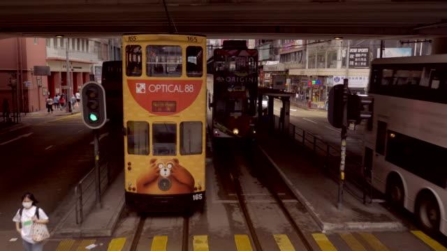 vidéos et rushes de moving shot along tram line in hong kong - ligne de tramway