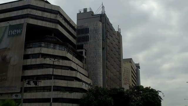 moving shot of a building in the city/ nairobi/ kenya - nairobi stock videos and b-roll footage