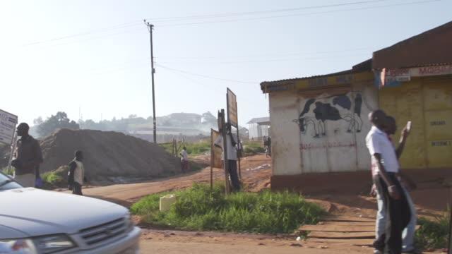 moving shot of street in uganda - ウガンダ点の映像素材/bロール