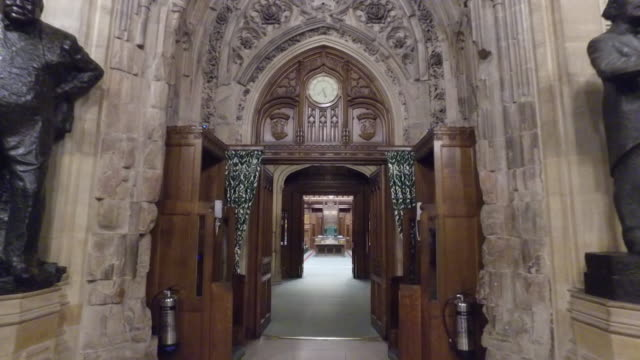 moving shot through door of house of commons and into the empty chamber - house of commons stock videos & royalty-free footage