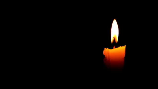 HD Moving single lit candle flame in the wind