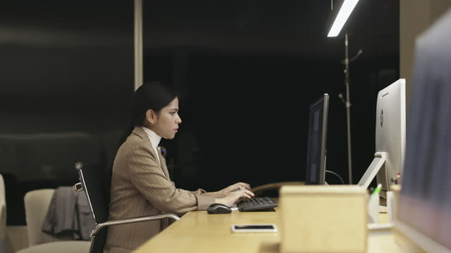 Moving Slow Motion Video of Diverse Male and Female Coworkers Working Late at Night