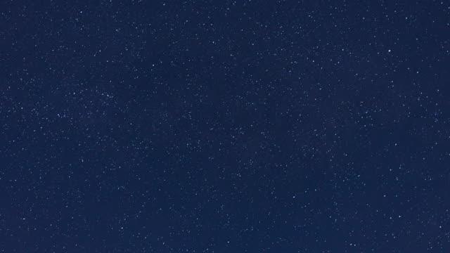 4k: moving star field at midnight - midnight stock videos and b-roll footage