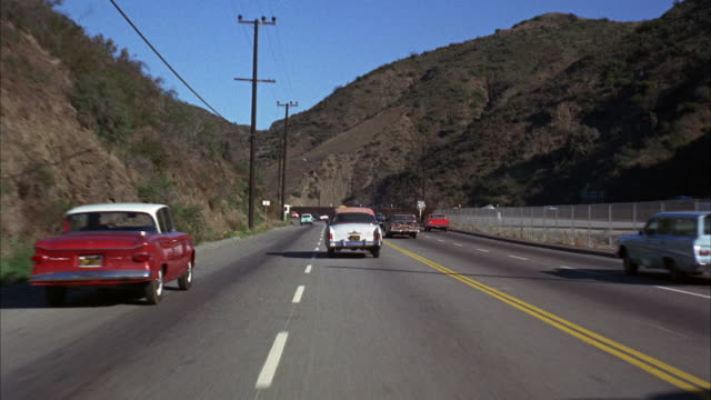 ms pov moving straight view of road / los angeles, california, united states - limousine familienfahrzeug stock-videos und b-roll-filmmaterial