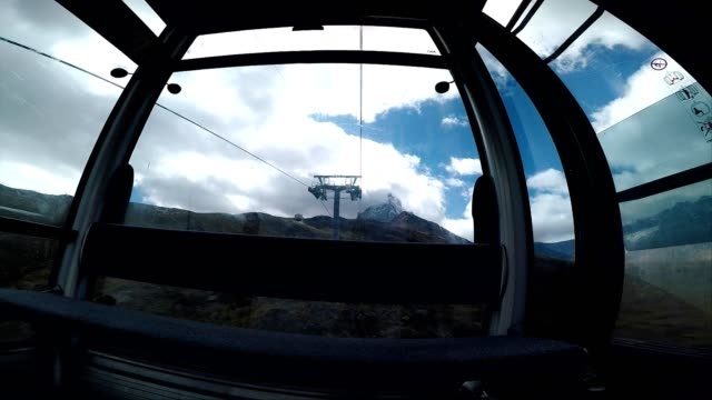 moving swiss alps mountain cable car interior view - ski lift point of view stock videos & royalty-free footage