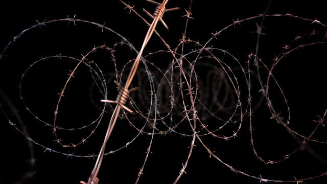 moving through barbed wire - loopable, selective focus, alpha, hd - barbed wire stock videos & royalty-free footage