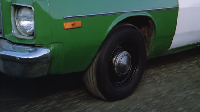 CU TS Moving tire of sheriff's patrol car