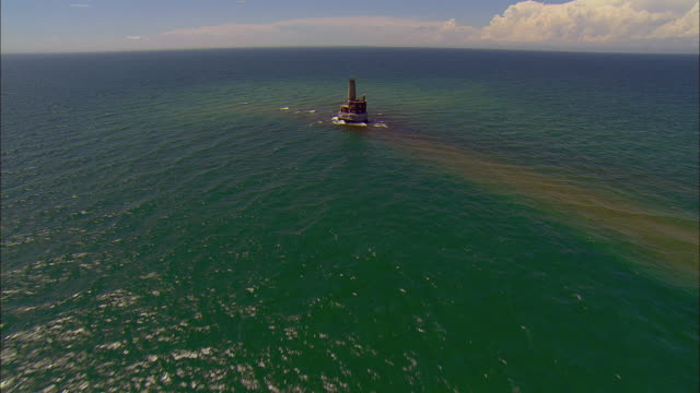 AERIAL Moving toward abandoned Waugoshance Lighthouse in Lake Michigan/ Cross Village, Michigan
