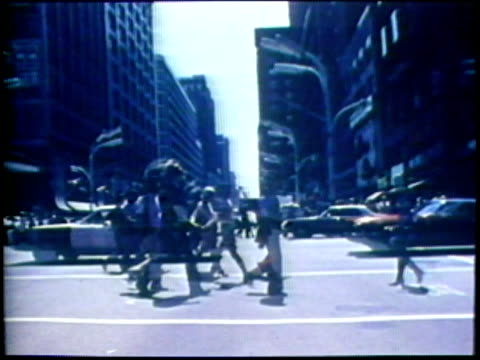 1973 montage ws pov moving towards pedestrians crossing city street/ ms passing train/ usa/ audio - 1973 stock videos & royalty-free footage