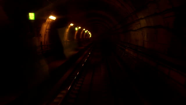 Moving train in subway tunnel - time lapse