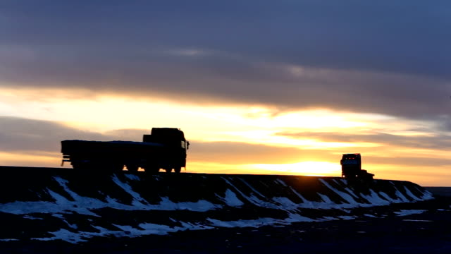 moving truck on country road in golden cloud sky - tir video stock e b–roll