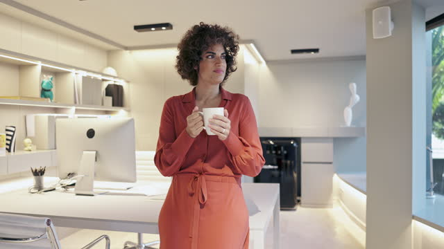 Moving Video Portrait of Female Designer with Coffee in Modern Office