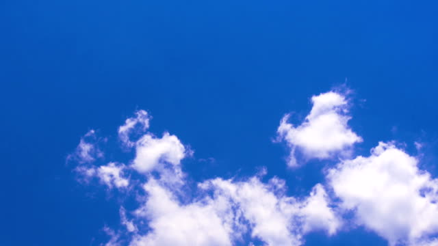 Moving white clouds under blue sky HD Time Lapse Video