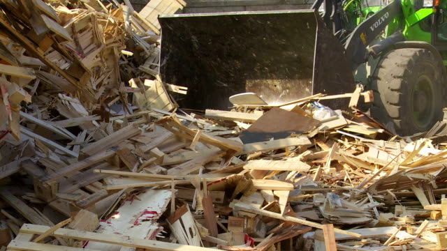 moving wood garbage in a recycling center - wood material stock videos & royalty-free footage