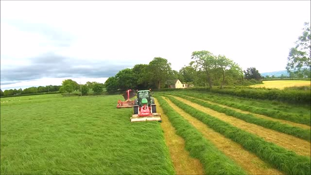 mowing a lawn has never looked so mesmerizing. filmed in carlow, ireland, the drone follows pa and cecil as they mow the grass at their massive farm.... - psychedelic stock videos & royalty-free footage