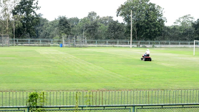 mowing at football field - lawn mower stock videos and b-roll footage