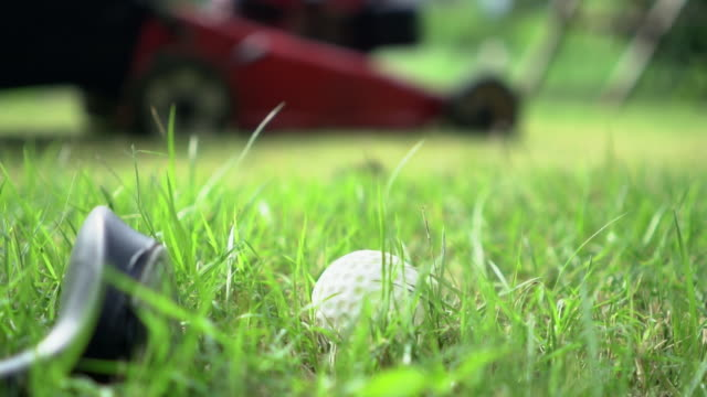 mowing grass in golf course: slowmotion - green golf course stock videos & royalty-free footage