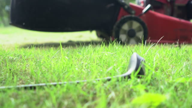 mowing grass : slowmotion - lawn mower stock videos and b-roll footage
