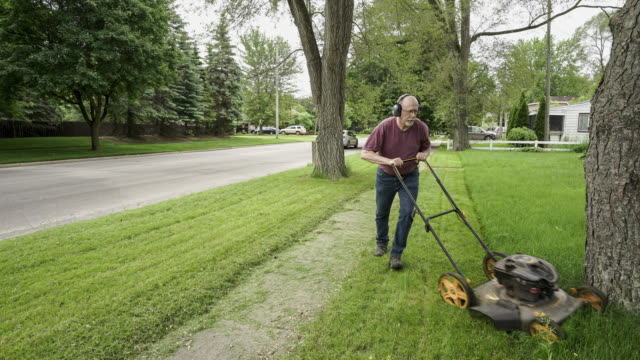 mowing the lawn - mowing stock videos & royalty-free footage