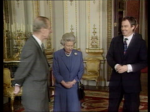 mowlam's comments on royal family casue political row lib buckingham palace prime minister tony blair mp standing with queen elizabeth ii and prince... - tony blair stock-videos und b-roll-filmmaterial