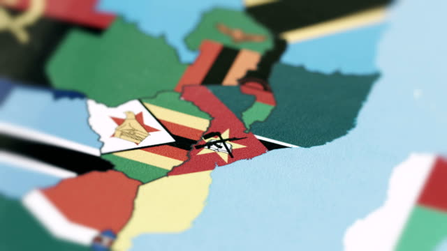 vídeos de stock e filmes b-roll de mozambique borders with national flag on world map - moçambique