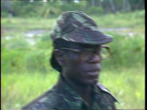 story 3:; mozambique: ext side frelimo government infantry unit l-r on patrol troops on patrol r-l cms leg and foot of soldier tilt up across... - lowering stock videos & royalty-free footage
