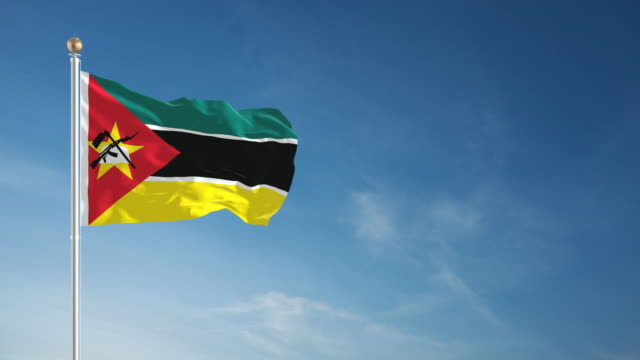 4k mozambique flag - loopable - flag stock videos & royalty-free footage