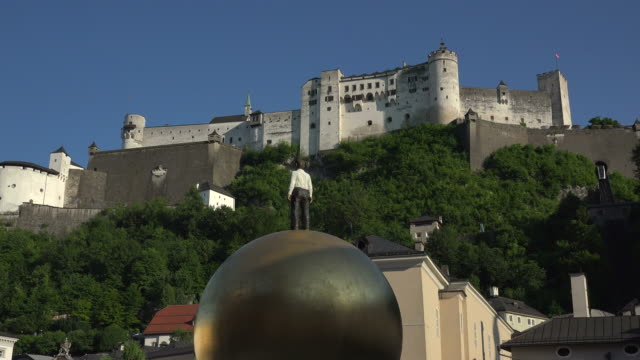 Mozart Ball by Sculptor Stephan Balkenhol, Sphaera Artwork on Kapitelplatz Square with Fortress Hohensalzburg, Austria