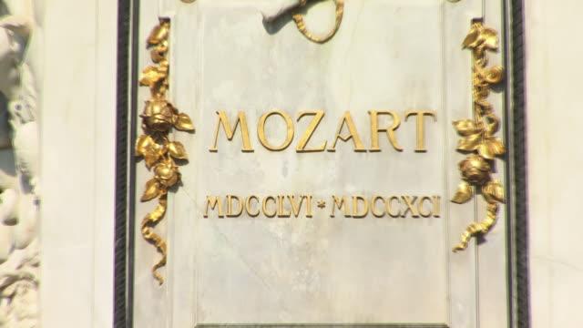 zo, ms, mozart statue in burggarten park, vienna, austria - composer stock videos & royalty-free footage