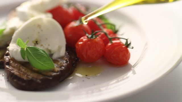 cu pan mozzarella salad on serving plate / london, united kingdom - cucina mediterranea video stock e b–roll