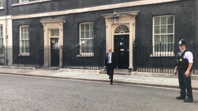 stockvideo's en b-roll-footage met mps arrive and leave number 10 as boris johnson puts together his cabinet michael gove sajid javid priti patel and ben wallace are seen in downing... - downing street
