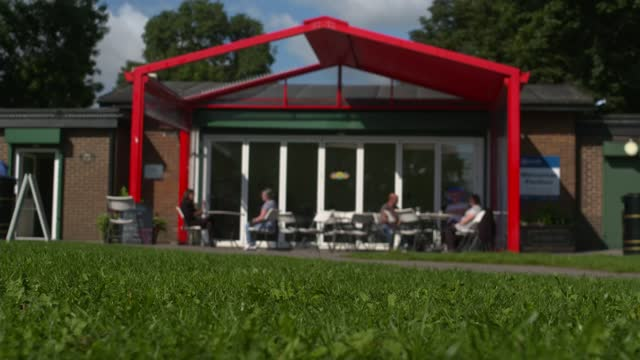 mps back non-binding motion to cancel universal credit cut; england: leeds: ext various exterior shots of community centre cafe int gvs of nicola... - politics stock videos & royalty-free footage