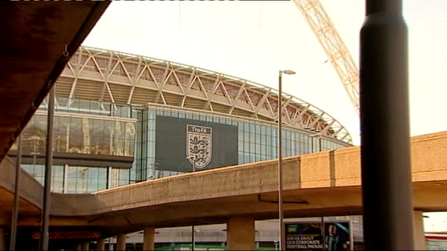 stockvideo's en b-roll-footage met mps call for more to be done to combat racisim in football; r03021214 / tx wembley stadium: general view of stadium with 'the fa' sign zoom in 'the... - english football association