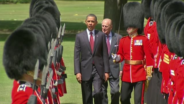 MPs debate Donald Trump's travel ban / thousands attend protest in Whitehall LIB / 2452011 Then President Barack Obama inspecting Guard of Honour...