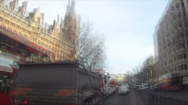 MPs debate national strategy on cycling ENGLAND London EXT Mike Cavenett cycling along road Mike Cavenett interview SOT S POINT OF VIEW from helmet...