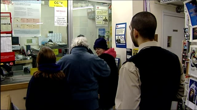 mps debate possible post office closures; england: london: highgate: ext exterior of highgate post office int back view customers queuing at post... - highgate stock videos & royalty-free footage