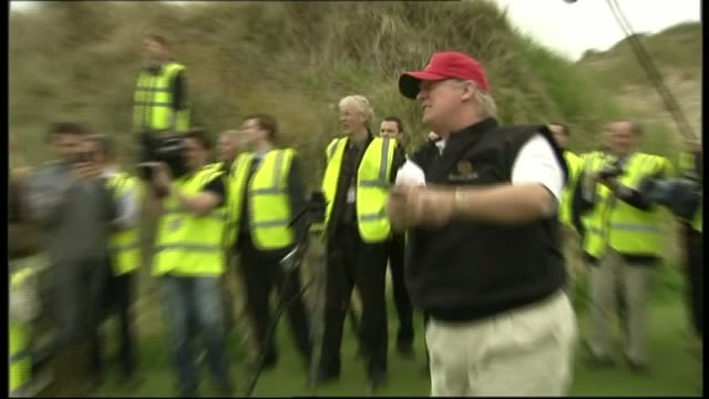 mps debate proposed ban on donald trump entering uk t20061131 / tx aberdeenshire menie estate ext donald trump teeing off on golf course surrounded... - golf stock-videos und b-roll-filmmaterial